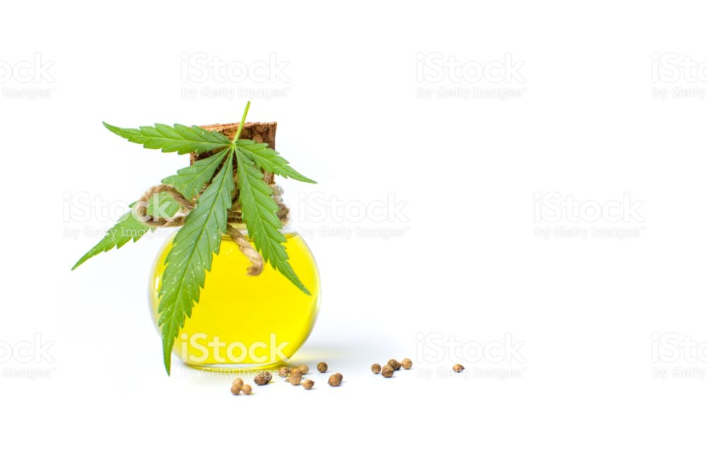 Marijuana leaf and cannabis oil isolated on white